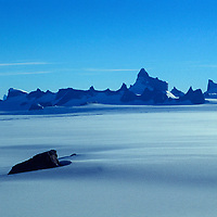 ANTARCTICA, Queen Maud Land. Fenris Mts. with a nunatak in the foreground. Mt. Ulvetanna is highest peak.