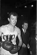 25/01/1963<br /> 01/25/1963<br /> 25 January 1963<br /> National Junior Boxing Championships at the National Stadium, Dublin. Picture shows W. Quinlan (U.C.D.) with his trophy after defeating D. Burns (Crown) for the Middleweight Championship.