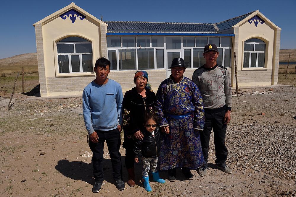 Mongolian Shepherd family members, from left: Manduhu, Li Wu Yue, Bai Shuang Xi, their daughters husband and their son in front, Inner Mongolia, China