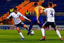 Mathew Hudson of Bury and Krystian Pearce of Mansfield Town tussle for the ball - Mandatory by-line: Ryan Crockett/JMP - 04/12/2018 - FOOTBALL - One Call Stadium - Mansfield, England - Mansfield Town v Bury - Checkatrade Trophy