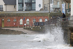© London News Pictures. 02/06/2015. United Kingdom, Swanage. Waves crash against the seafront. Grey skies cover the sky over a windy seafront at Swanage, Dorset, on June 2, 2015. Photo credit: LNP