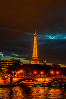 The lights along the River Seine and the illuminated Eiffel Tower at night, Paris, France.