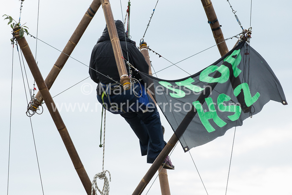 West Hyde, UK. 9th September, 2020. An Anti-HS2 activist uses a tripod to block one of several entrances to the Chiltern Tunnel South Portal site for the HS2 high-speed rail link for the entire day. The protest action, at the site from which HS2 Ltd intends to drill a 10-mile tunnel through the Chilterns, was intended to remind Prime Minister Boris Johnson that he committed to remove deforestation from supply chains and to provide legal protection for 30% of UK land for biodiversity by 2030 at the first UN Summit on Biodiversity on 30th September.