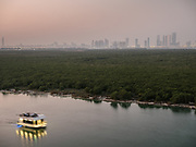 Sunset with a view towards Abu Dhabi skyline from the Mangrove National Park, one of the Emirate's most important ecological asset.