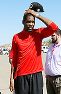NBA Oklahoma City Thunder star  forward Kevin Durant reacts as he looks at the tornado-destroyed  Briarwood elementary school in Oklahoma City, Oklahoma May 22, 2013.  Durant's foundation donated $1 million USD to the American Red Cross for tornado relief.   Rescue workers with sniffer dogs picked through the ruins on Wednesday to ensure no survivors remained buried after a deadly tornado left thousands homeless and trying to salvage what was left of their belongings. Curvature of horizon in the photo is due to an ultra-wide angle lens.  REUTERS/Rick Wilking (UNITED STATES)