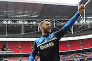 Callum Kennedy defender for AFC Wimbledon (3) celebrates as AFC Wimbledon win promotion to league 1after the Sky Bet League 2 play off final match between AFC Wimbledon and Plymouth Argyle at Wembley Stadium, London, England on 30 May 2016. Photo by Stuart Butcher.