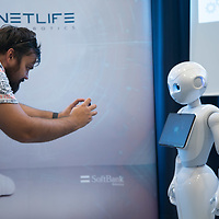 Man takes pictures with his mobile phone of a Pepper customer service robot that takes part in a press conference introducing the development plans of Hungary's Netlife Robotics company in Budapest, Hungary on Sept. 6, 2018. ATTILA VOLGYI