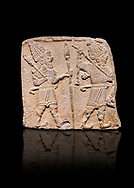 Aslantepe Hittite relief sculpted orthostat stone panel. Limestone, Aslantepe, Malatya, 1200-700 B.C. Anatolian Civilizations Museum, Ankara, Turkey. Scene of two Gods walking one carrying a spear, dressed in tunics.<br /> <br /> Against a black background.<br /> <br /> If you prefer to buy from our ALAMY STOCK LIBRARY page at https://www.alamy.com/portfolio/paul-williams-funkystock/hittite-art-antiquities.html . Type - Aslantepe - in LOWER SEARCH WITHIN GALLERY box. Refine search by adding background colour, place, museum etc.<br /> <br /> Visit our HITTITE PHOTO COLLECTIONS for more photos to download or buy as wall art prints https://funkystock.photoshelter.com/gallery-collection/The-Hittites-Art-Artefacts-Antiquities-Historic-Sites-Pictures-Images-of/C0000NUBSMhSc3Oo