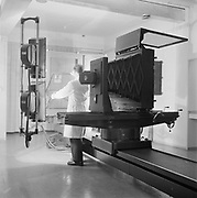 Photographer using large plate camera in printing works studio, Finland 1959