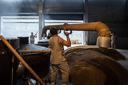 A worker connects two parts of steam vat filled with fermented grain at a baijiu production facility that is part of the Shuijingfang museum, operated by Sichuan Swellfun Co., a unit of Diageo Plc in Chengdu, China, on Tuesday, Sept. 20, 2016. With less than 1 percent of baijiu, or white liquor, consumed abroad, Chinese distillers want to transform the fiery Chinese grain liquor into the new tequila for Americans and Europeans.