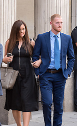 © Licensed to London News Pictures. 13/08/2018. Bristol, UK. BEN STOKES and his wife CLARE RATCLIFFE leave Bristol Crown court at today at the start of the second week of his trial on charges of affray that relate to a fight outside a Bristol nightclub on September 25 2017. England cricketer Ben Stokes and Ryan Ali, 28 deny the charge. Stokes and Ali are charged with affray in the Clifton Triangle area of Bristol on September 25 last year, several hours after England had played a one-day international against the West Indies in the city. Ali allegedly suffered a fractured eye socket in the incident. Photo credit: Simon Chapman/LNP
