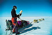 Reading while dog sledging and skiing across Greenland icecap, Arctic