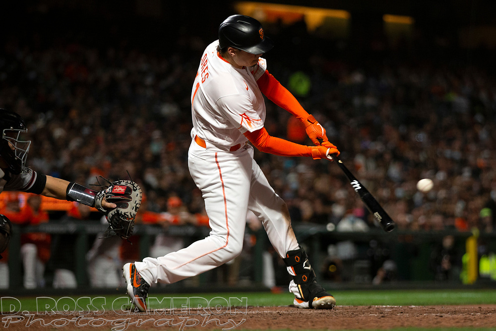 San Francisco Giants pinch hitter Wilmer Flores (41) connects for an RBI single against the Arizona Diamondbacks during the sixth inning of a baseball game, Tuesday, Sept. 28, 2021, in San Francisco. Evan Longoria scored on the hit. (AP Photo/D. Ross Cameron)