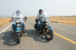 Father and son ride together - Ken McManus rides his 1936 Harley-Davidson Knucklehead beside his son Matt McManus on an exactly identical machine during Stage 13 (257 miles) of the Motorcycle Cannonball Cross-Country Endurance Run, which on this day ran from Elko, NV to Meridian, Idaho, USA. Thursday, September 18, 2014.  Photography ©2014 Michael Lichter.