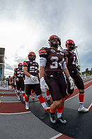 KELOWNA, BC - AUGUST 17:  Jack Proskow #52, Jonah Williams #34 and Adam Burton #11 of Okanagan Sun walk to the field against the Westshore Rebels  at the Apple Bowl on August 17, 2019 in Kelowna, Canada. (Photo by Marissa Baecker/Shoot the Breeze)