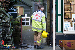 © Licensed to London News Pictures. 08/12/2015. Glen ridding UK. A massive clean up operation has started in the village of Glenridding that has been cut of from the outside world for four days with no water, electricity or telephone lines after huge torrents of water from the surrounding mountains destroyed roads leading to it & flooded the village centre. Photo credit: Andrew McCaren/LNP