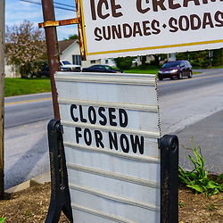 White Horse, PA / USA - May 3, 2020: A closed for now sign at a small ice cream shop in south central Pennsylvania.