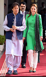The Duchess of Cambridge walks alongside the Prime Minister of Pakistan Imran Khan during a visit to his official residence in Islamabad on the second day of the royal visit.