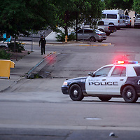 070815       Cable Hoover<br /> <br /> Gallup police block off Hill Avenue at First Street as the investigate a bomb threat at Octavia Fellin Public Library Wednesday evening.
