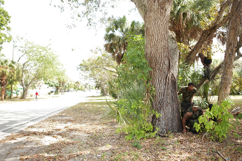 "TimWes, bottom, records a video with Gutta Slim and Naples rapper, Sho Zoe, for a song called ""Flaggin' and Flexin'"" on Lemon Street in Fort Myers, Fla. The Fort Myers police showed up to the video shoot because an anonymous caller said they saw suspicious activity taking place. The police only asked if there were any guns involved. TimWes explained that his music goes against that."