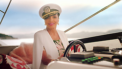 Dame Joans Collins takes to the high seas and dons a captain's hat in a new comical ad campaign for mobile phone network Three. The 86-year-old actress and Hollywood icon calls on phone customers to 'ditch and switch' their phone network to mark an industry-wide change in the UK allowing mobile users to change networks by sending a simple free text. The ad draws on five-times-married Collins's vast dating experience to encourage viewers to take control and not stay in an 'unsatisfactory relationship'. The Golden Globe star is seen living the high life on-board a yacht in sunny St Tropez, with playful nods towards the benefits of choosing 'the one', before she turns to the camera to say: 'I've never settled for anyone or anything which didn't float my boat… 'It's now easier than ever to switch. So darling if they're not satisfying you, then just... ghost them. So, take control - ditch and switch to Three.' Speaking about the campaign, Collins said: 'Having been married a few times, I can tell you now that staying with someone just to be in a relationship won't make you happy. 'It took me a long time to find 'the one' because I was never ever going to settle for second best. The relationship you have with your mobile network shouldn't be any different – when you start to feel unloved, dissatisfied and you can't see past those niggles, it's time to move on, darling.' Launching on 2 July, mobile customers can get the code they need to switch networks by simply sending a free text message – rather than having to call their current provider – and can switch mobile networks in just one working day. To mark this, Three is offering new and upgrading customers six months half price line rental, on its Unlimited tariff (24 month Advanced Plan). This offer is available now until 22 August, on a range of handsets, Home, Tablet and SIM only plans. For example, a 24-month SIM-only Advanced Plan with unlimited data, calls