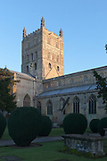 Exterior of north and west facing facade of Tewkesbury Abbey at sunset