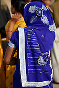 Hindu pilgrim with blue sari at Dashashwamedh Ghat in holy city of Varanasi, Benares, India