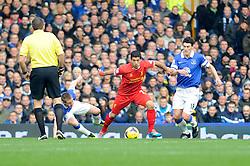Liverpool's Luis Suarez holds the ball from Everton's Gareth Barry - Photo mandatory by-line: Dougie Allward/JMP - Tel: Mobile: 07966 386802 23/11/2013 - SPORT - Football - Liverpool - Merseyside derby - Goodison Park - Everton v Liverpool - Barclays Premier League