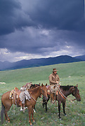"""LIVINGSTON, MT - AUGUST:  Famed horse trainer Buck Brannaman stands by with his horses during the filming of """"The Horse Whisperer"""" in 1997. (Photo by John Kelly/Getty Images)"""