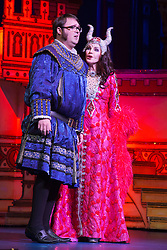 "© Licensed to London News Pictures. 06/12/2012. London, England. Jarred Christmas as the Henchman"" and Priscilla Presley as the Wicked Queen. Priscilla Presley makes her pantomime debut in ""Snow White and the Seven Dwarfs"" at the New Wimbledon Theatre, Wimbledon, from 7 December 2012 to 13 January 2013. Warwick Davis and Jarred Christmas star alongside her. Images from the Dress Rehearsal. Photo credit: Bettina Strenske/LNP"