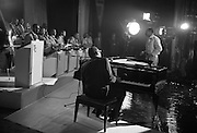 """Singer Ray Charles at the piano at the Gaiety Theatre, filming a scene for the film """"Ballad in Blue""""..09.06.1964"""
