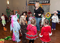 Music with Mar's Julie Wirth gets trick or treaters on their feet dancing and singing during Gilford Public Library's Halloween party and parade Friday morning.  (Karen Bobotas/for the Laconia Daily Sun)
