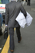 businessman walking with his bed sheets under his arm