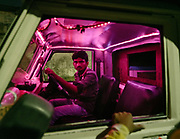 A colorful pink and purple interior of a car.
