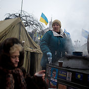 December 19, 2013 - Kiev, Ukraine: A pro-EU demonstrator distributes tea at the Independence Square.<br /> On the night of 21 November 2013, a wave of demonstrations and civil unrest began in Ukraine, when spontaneous protests erupted in the capital of Kiev as a response to the government's suspension of the preparations for signing an association and free trade agreement with the European Union. Anti-government protesters occupied Independence Square, also known as Maidan, demanding the resignation of President Viktor Yanukovych and accusing him of refusing the planned trade and political pact with the EU in favor of closer ties with Russia.<br /> After a days of demonstrations, an increasing number of people joined the protests. As a responses to a police crackdown on November 30, half a million people took the square. The protests are ongoing despite a heavy police presence in the city, regular sub-zero temperatures, and snow.  (Paulo Nunes dos Santos/Polaris)
