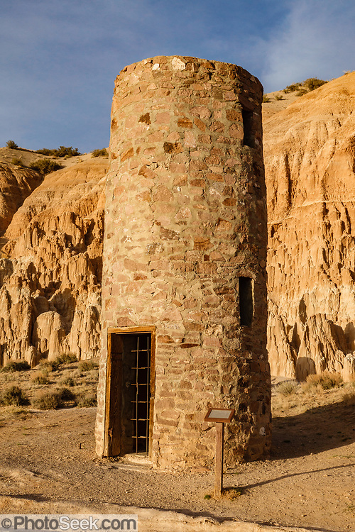 1930s CCC stone water tower at Cathedral Gorge State Park, Panaca, Nevada, USA. The stone water tower was built by the Civilian Conservation Corps (CCC) in the 1930s but is no longer in use. Million-year-old lake sediments have eroded into fantastic mud castles at Cathedral Gorge State Park.