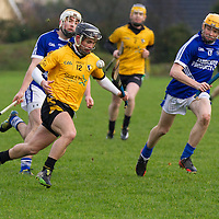 Cratloe's Cathal O'Connell gets away with the slíotar chased by Cratloe's Conor McGrath and David Collins