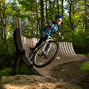 Chris Vivelo, 12, rides his mountain bike on a wall ride obstacle at the municipal mountain bike trails, in Franklin, Tennessee. Nathan Lambrecht/Journal Communications