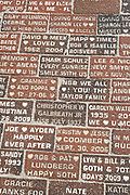 Bricks engraved with messages along the historic Flagler Avenue shopping district in New Smyrna Beach, Florida.