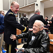 U.S. Army General Stephen Lyons (left) jokes with Army Air Corps veteran Fred Bruss of Freeburg after the ceremony concluded. Lyons, who is Commander of US Transportation Command at Scott Air Force Base, was the guest speaker. After WWII Bruss was in the Belleville Fire Department for 30 years. The city of Belleville held their 21st annual Veterans Day ceremony inside Belleville City Hall on Thursday November 11, 2019. It was moved inside due to the winter weather.<br /> Photo by Tim Vizer