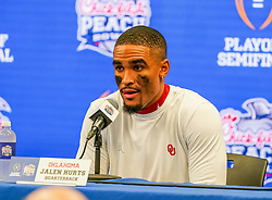 Oklahoma Sooners  quarterback Jalen Hurts (1) at the press conference after  the 2019 College Football Playoff Semifinal at the Chick-fil-A Peach Bowl on Saturday, Dec. 28, in Atlanta. (Marvin Gentry via Abell Images for the Chick-fil-A Peach Bowl)