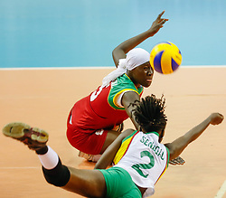 NAIROBI, Feb. 20, 2014  Seck Mbayang (Top) of Senegal and her teammate Gueye Aminata save the ball during the 2014 FIVB Women's Volleyball World Championship Qualifiers between Kenya and Senegal in Nairobi, capital of Kenya, Feb. 19, 2014. Senegal lost the match 1-3.  (Credit Image: RealTime Images)