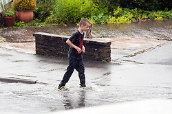 16:43 Ecclesfield Sheffield UK.The young lad makes his way up the Aptly named Floodgate Drive..5 July 2012.Image © Paul David Drabble