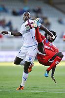 FOOTBALL - FRENCH CHAMPIONSHIP 2011/2012 - L1 - AJ AUXERRE v AC AJACIO  - 27/08/2011 - PHOTO GUY JEFFROY / DPPI - DENNIS OLIECH (AUX) / LEYTI N'DIAYA (AJA)