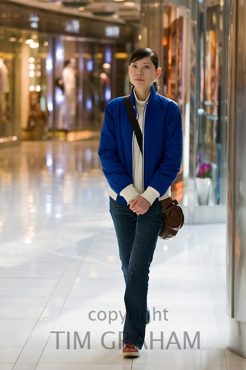 Shopper in the Citic Square Shopping Mall on Nanjing Road, central Shanghai, China