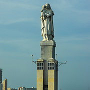 Magnificent sculpture dominates the entrance to the harbor in Cartagena, CVolombia.