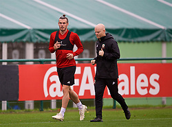 CARDIFF, WALES - Saturday, October 13, 2018: Wales' Gareth Bale and physiotherapist Sean Connelly (R) during a training session at the Vale Resort ahead of the UEFA Nations League Group Stage League B Group 4 match between Republic of Ireland and Wales. (Pic by David Rawcliffe/Propaganda)