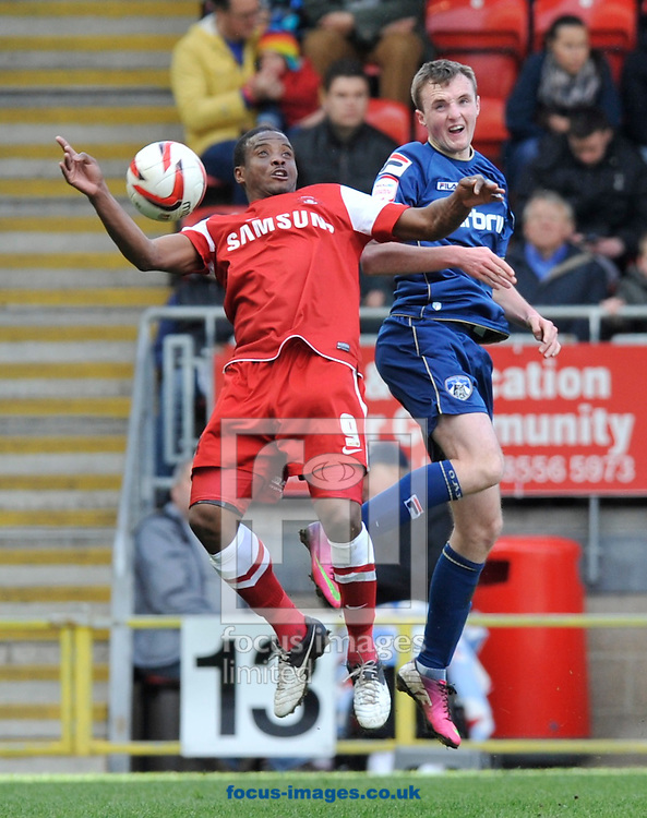 Picture by Alan Stanford/Focus Images Ltd +44 7915 056117.27/04/2013.Kevin Lisbie of Leyton Orient wins the ball from Carl Winchester of Oldham Athletic during the npower League 1 match at the Matchroom Stadium, London.. .