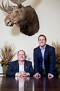 Sam Hollis, President & Co-Founder of Milestone Construction, and Travis Ruff, Co-Founder, pose for a photo in a conference room at the company on Monday, May 19, 2014, in Springdale, Ark.<br /> Photo by Beth Hall