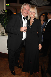 CHRISTOPHER BIGGINS and VIRGINIA BATES at a party to celebrate the publication of Michael Winner's new book 'Fat Pig Diet' held at The Belvedere, Holland Park, London on 17th October 2007.<br />